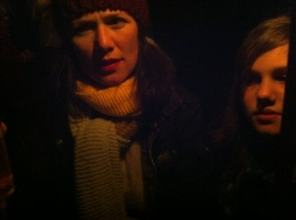 Lucia and Esme in torchlight